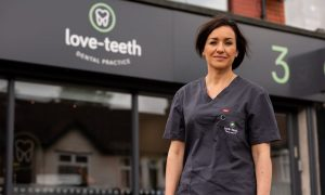 An image of Dr Ilana Pine, standing outside Love-Teeth Dental Practice.